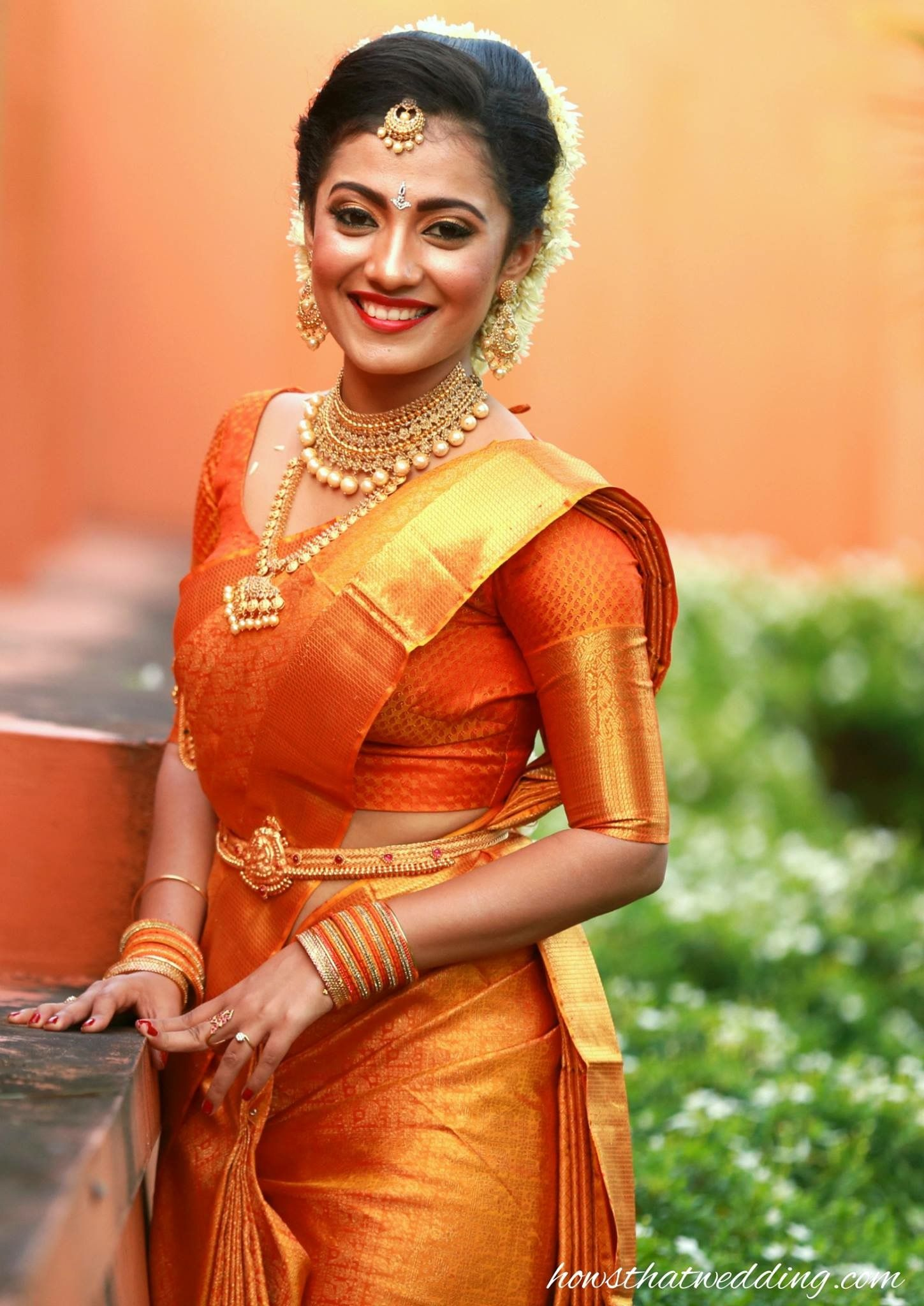 Pretty Bride With Elegant Yellow Musk Silk Saree Enhanced Beauty Of The Sandal Body Rich Contrast Tissue Border Merges Well And Brings