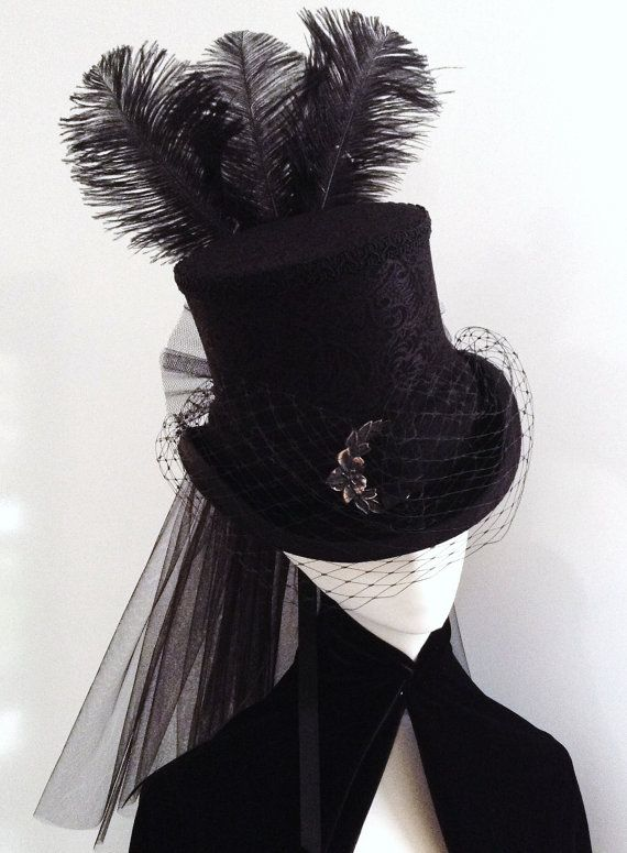 add9d3e9f226d0 Black riding top hat with black brocade lace, tulle rear veil, double satin  ribbons at back, silk braiding and featuring an aged buckle in front, ...