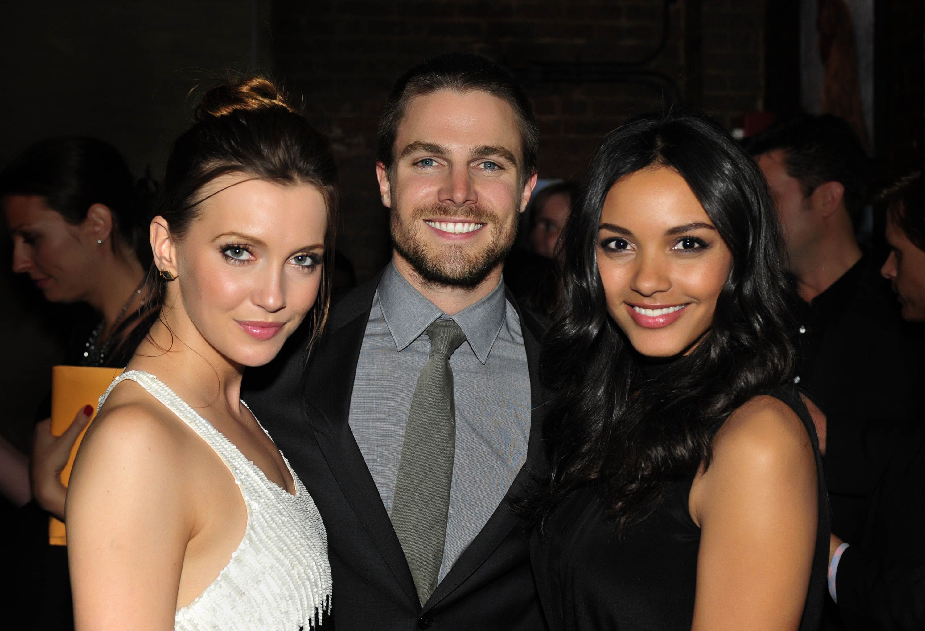 Katie Cassidy and Stephen Amell (ARROW) and Jessica Lucas (CULT) at The CW Upfront Party - Colicchio  Sons, New York, Thursday, May 17, 2012. Photo: Timothy Kuratek/CW 2012 CW Broadcasting Inc. All Rights Reserved.#Repin By:Pinterest++ for iPad#
