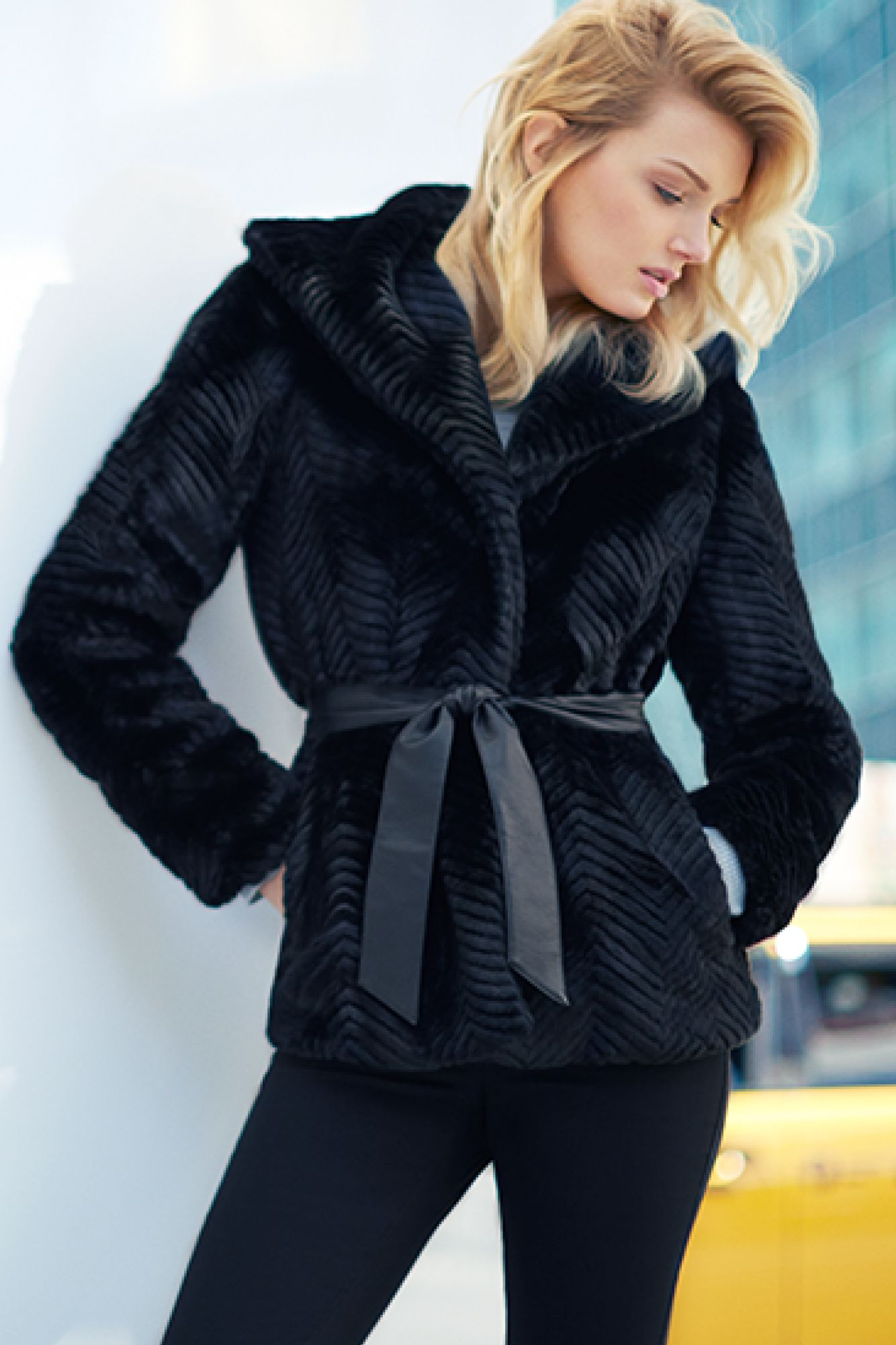 Black fitted fauxfur jacket with tie belt in imitation