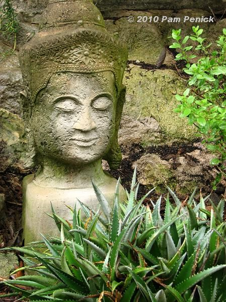 A Stone Buddha Head Matches The Texture Of The Limestone Wall Behind It In  Jeff Pavlatu0027s