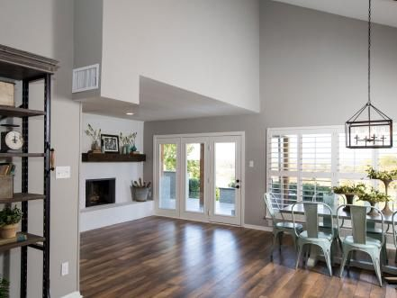 Replacing the carpet with hardwood flooring, painting the walls in a cool gray and closing off the upstairs railing substantively alters the feel of the living room while giving the space a decidedly fresh and open feel.