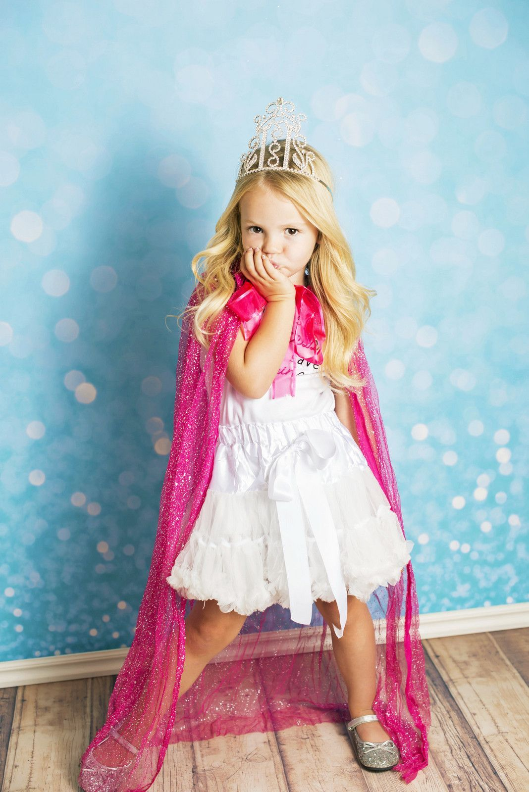 Long flowing, glittery tulle fabric with a bow tie at the
