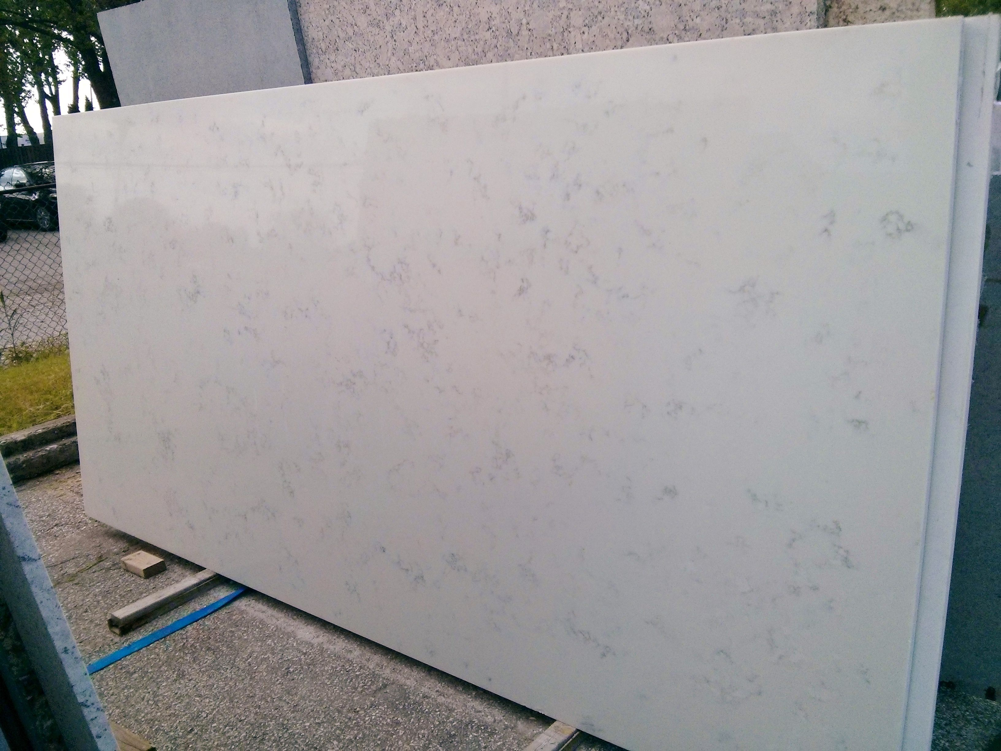Full Slab View Of Carrara Grigio Quartz The Look Of Marble With The Durability Of Quartz And The Fa Countertops Cabinets And Countertops Kitchen Countertops
