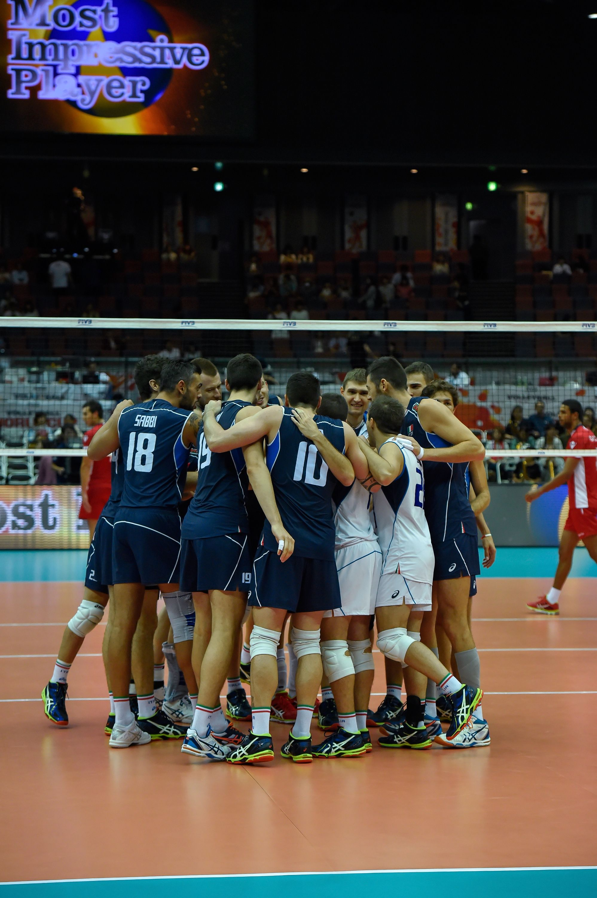 The Italian Players Form A Huddle After Winning The Match Over Tunisia Players Match Basketball Court