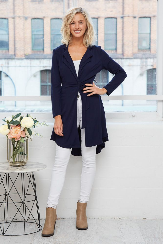 Melanie Jacket in Navy $79.90   The Melanie Jacket in Navy is the perfect choice to dress up or down when the day's are crisp! With a relaxed open front and solid hue, it's the perfect layering piece for the winter weather! Style yours over office attire or use it to elevate a casual outfit effortlessly.