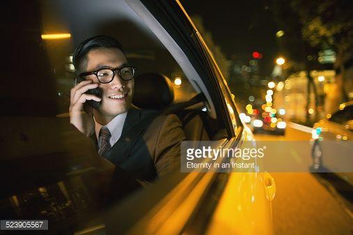 Foto de stock : Businessman using phone in car