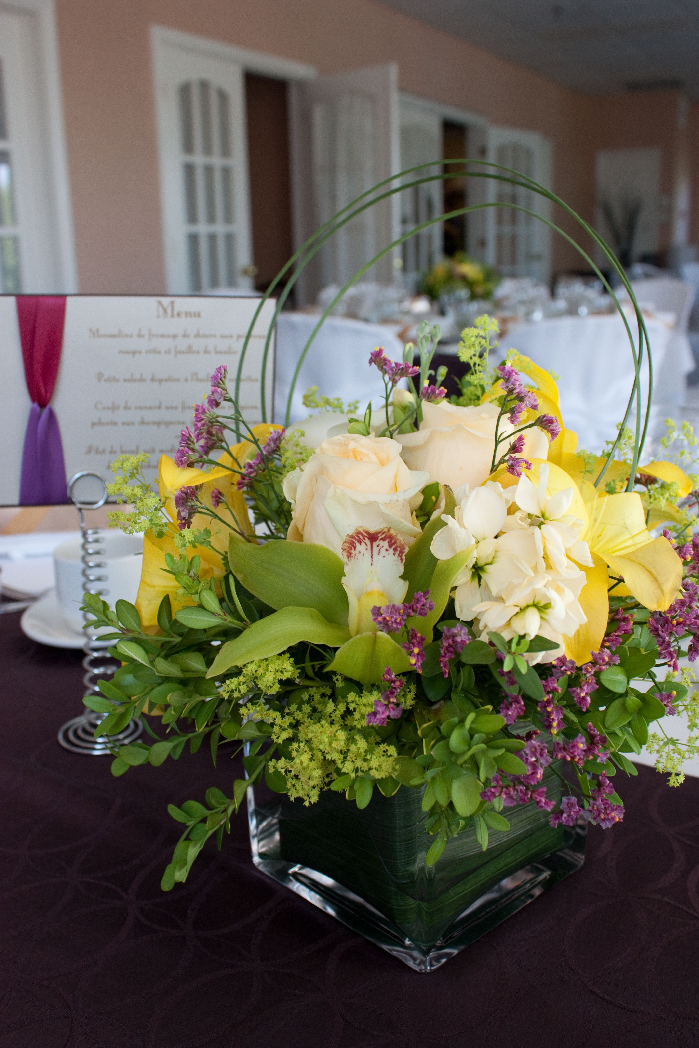 Table Centrepiece With Roses And Orchids