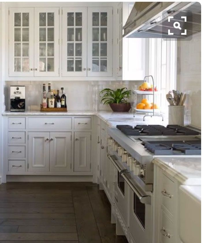 Fantastic Kitchen With Wire Brushed Oak Cabinets With Marble Countertops  And Marble Slab Backsplash.