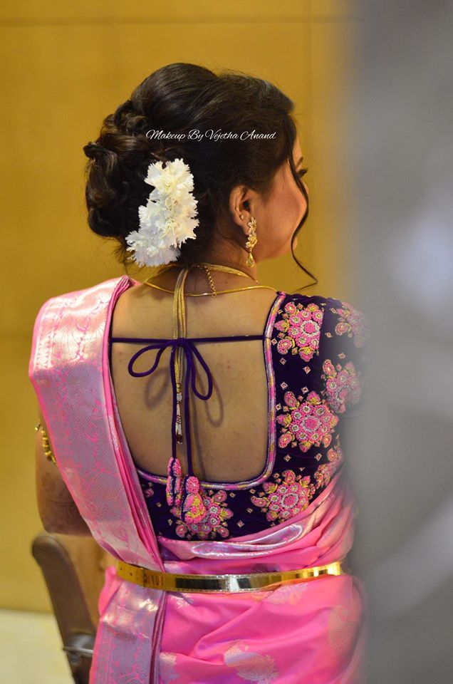 Indian bridal hairstyle. Up do. Hair bun with flowers. Pink silk saree with statement blouse ...