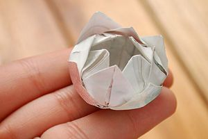 Make a simple origami lotus flower lotus flower origami and how to fold an origami lotus flower video and photos mightylinksfo