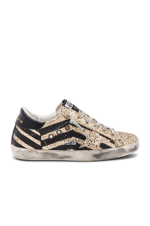 Golden Goose Superstar Sneaker in Gold
