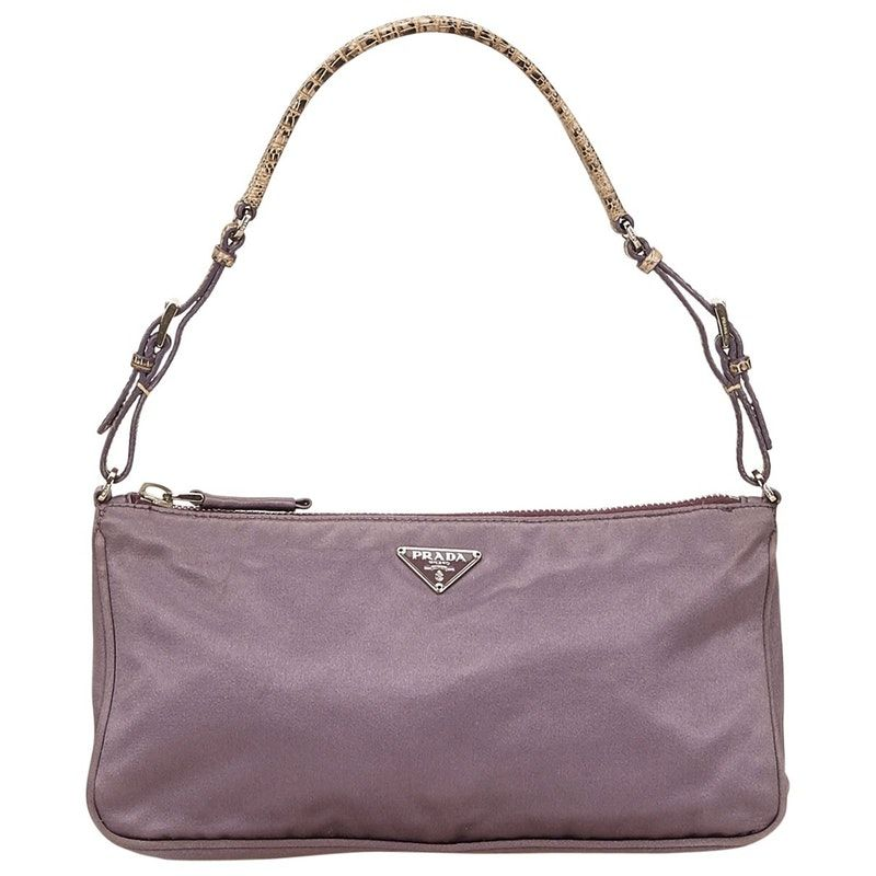 e9ee7d7cf3e5 Buy your handbag PRADA on Vestiaire Collective, the luxury consignment  store online. Second-hand Handbag PRADA Purple in Synthetic available.  4491906