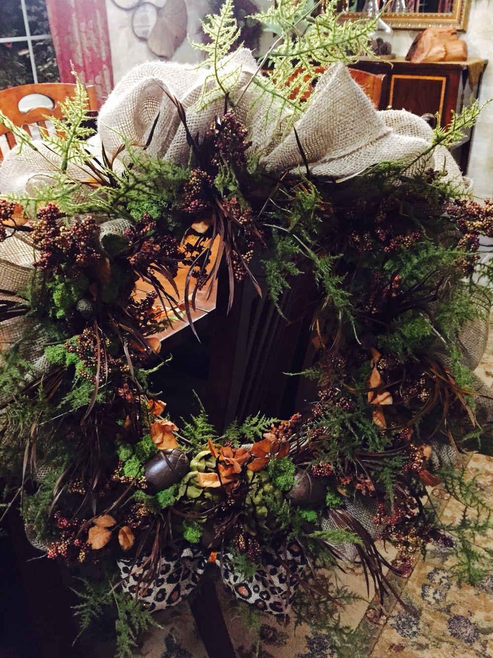 Fall wreath I made...burlap, moss, greenery, feathers, wooden acorns