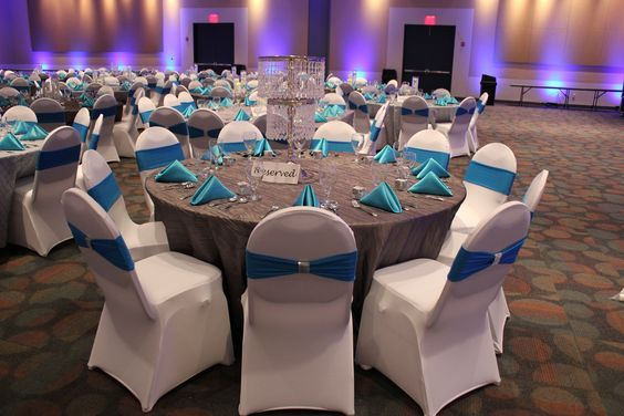 White Spandex Chair Cover With A Turquoise Band And Silver
