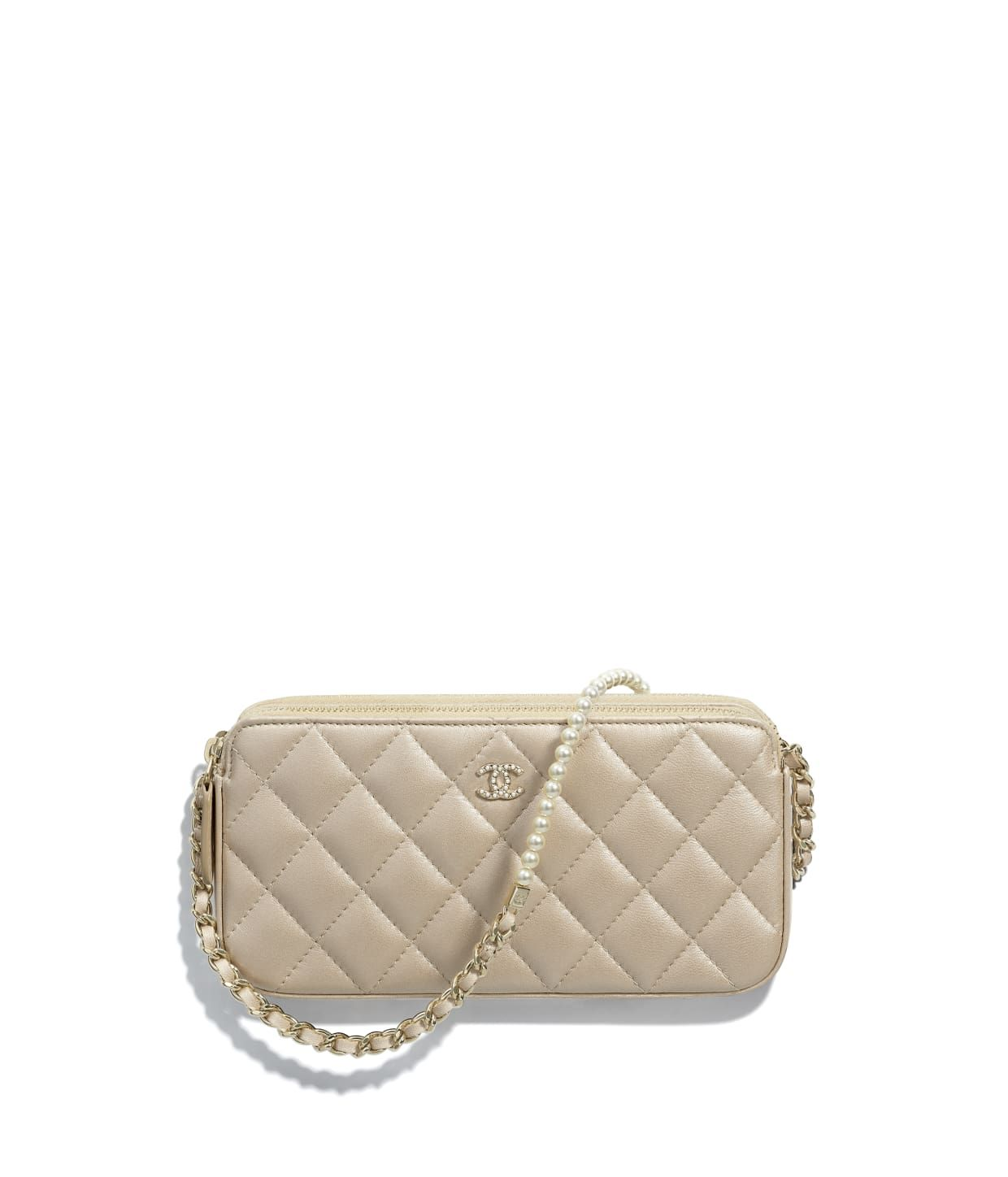 6beb7e95903a Discover the CHANEL Iridescent Lambskin   Gold-Tone Metal Beige Clutch with  Chain