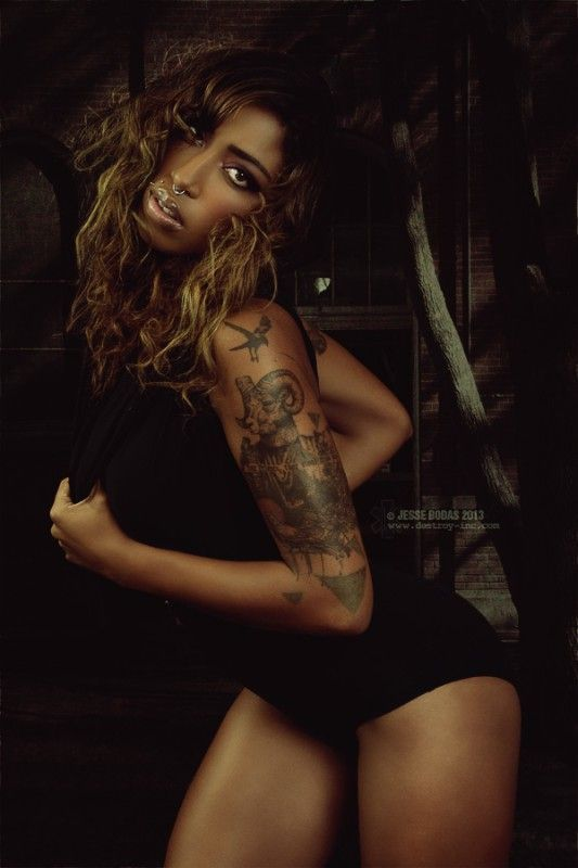 Love this etching-style tattoo on model Milloux Suicide! She rocks it! Photo by Jesse Bodas.