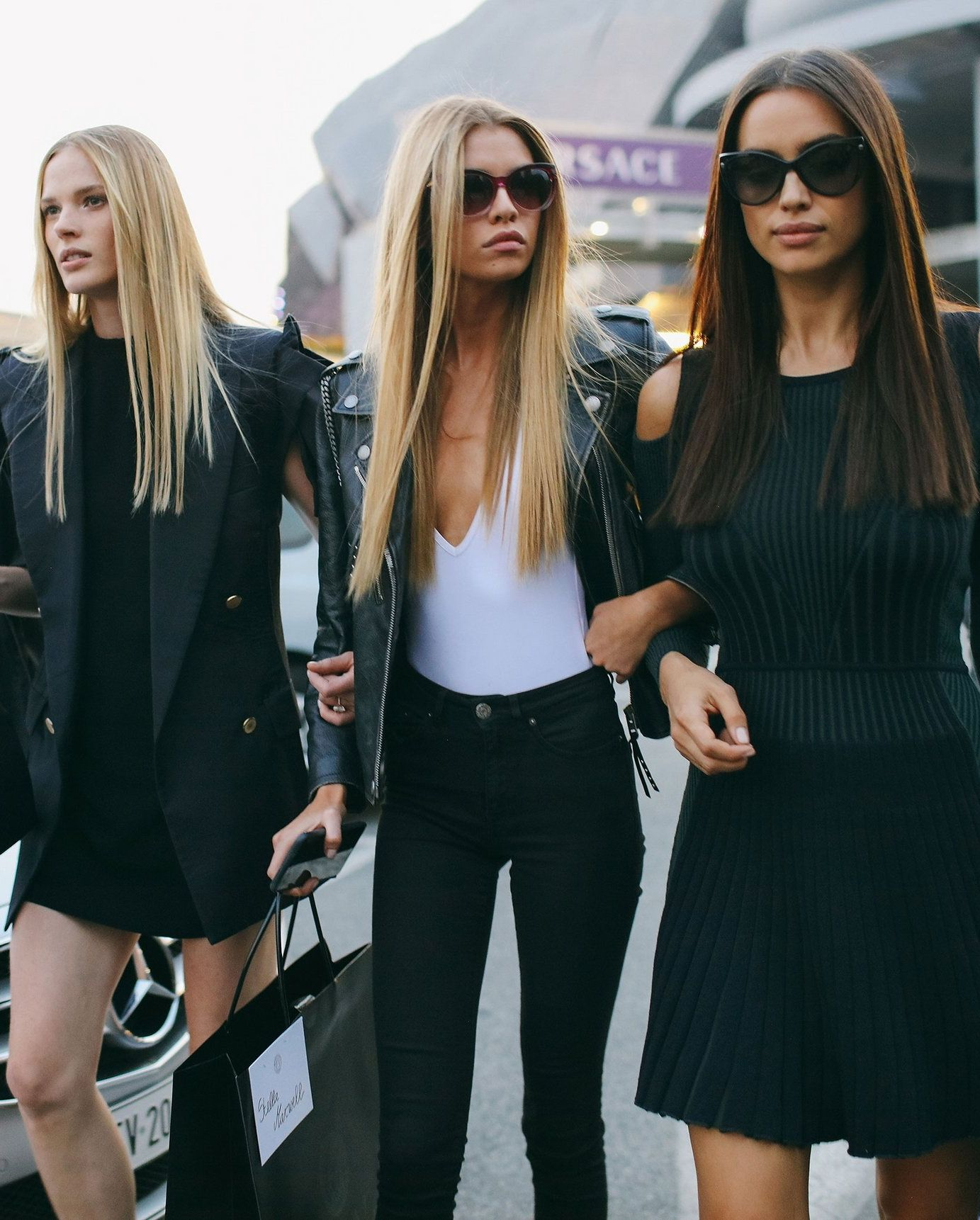 Anne V, Stella Maxwell, and Irina Shayk spotted on the street at Milan Fashion Week. Photographed by Phil Oh.