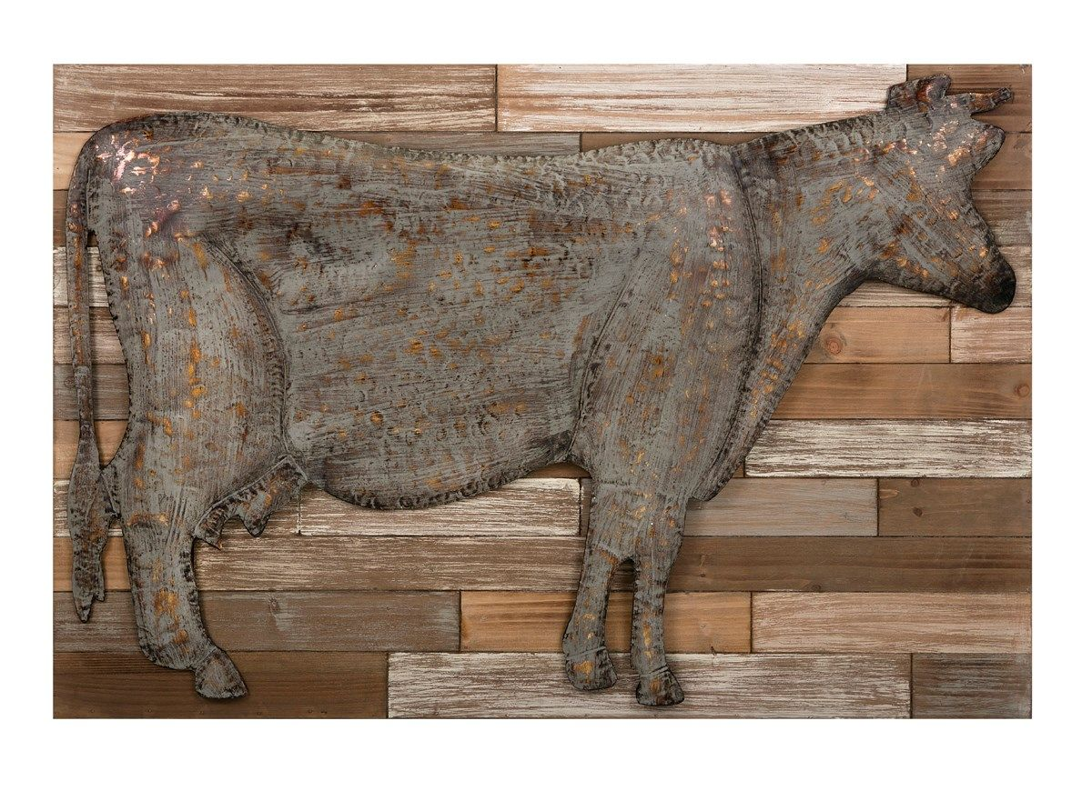 A distressed metal cow floats over a pallet wood inspired ...