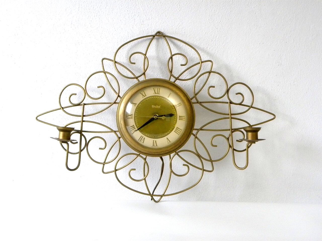 Vintage Mid-Century 1950s/60s United Gold Wire Wall Clock and Candle Holder by mockingbirdroad on Etsy https://www.etsy.com/listing/200834228/vintage-mid-century-1950s60s-united-gold