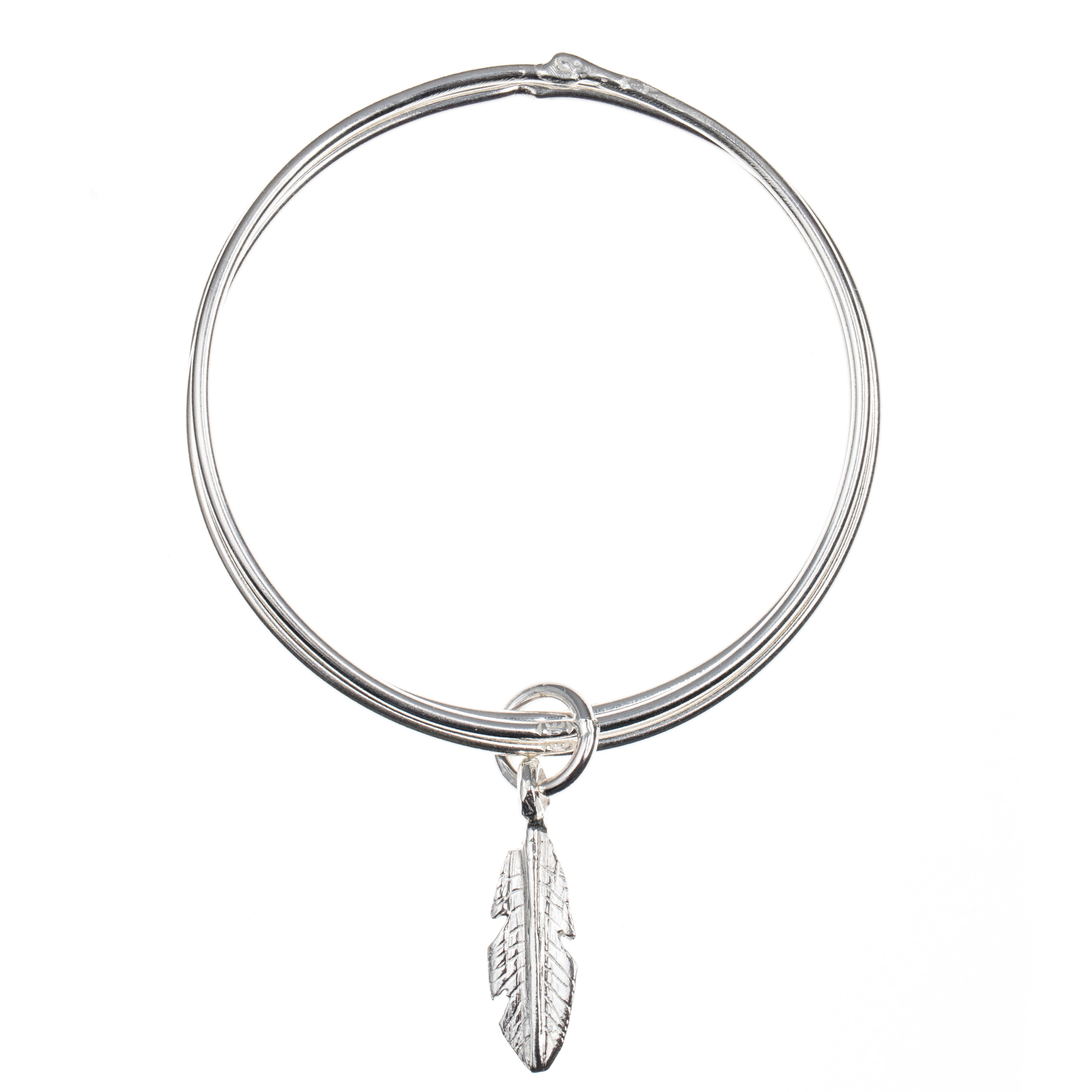 These solid silver stacked bangles should be worn piled up high. Get your collection off to a flying start with this set of three thin stack bangles with a medium heart charm. As worn and favoured by Kate Moss.