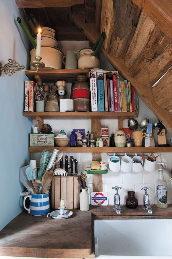 Nice, tastefully organized shelves underneath the stairs.   ---the Kitchens Under the Stairs-46-1 Kindesign