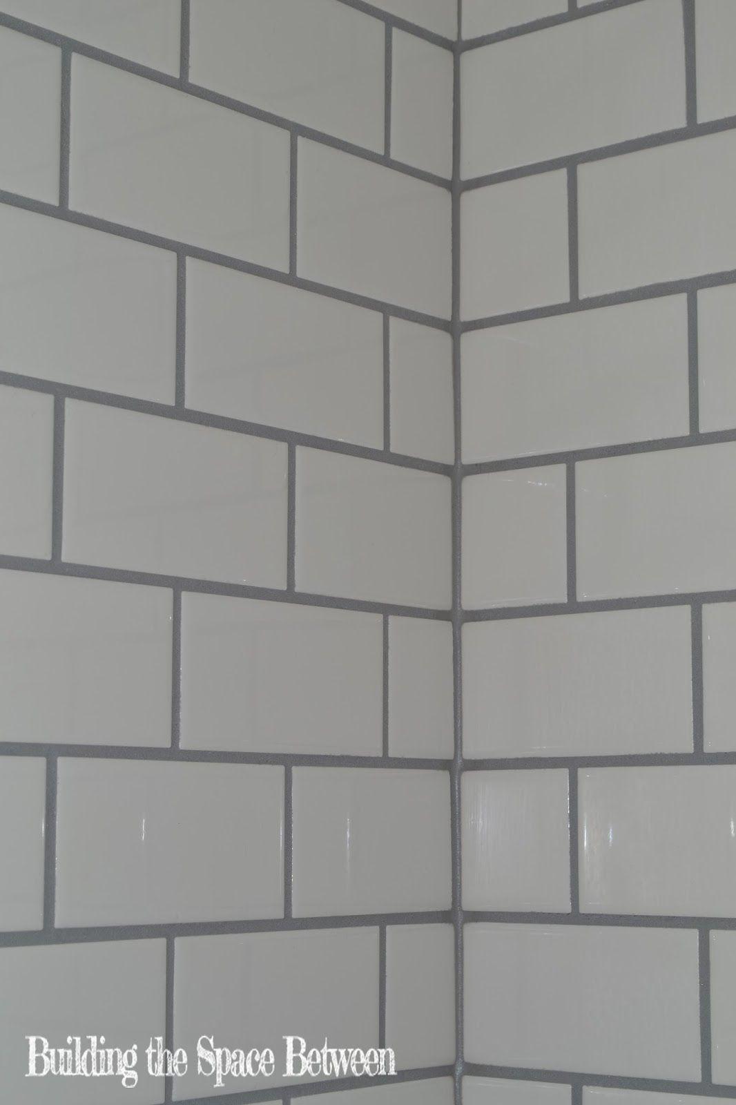 grey grout white subway tile bathroom
