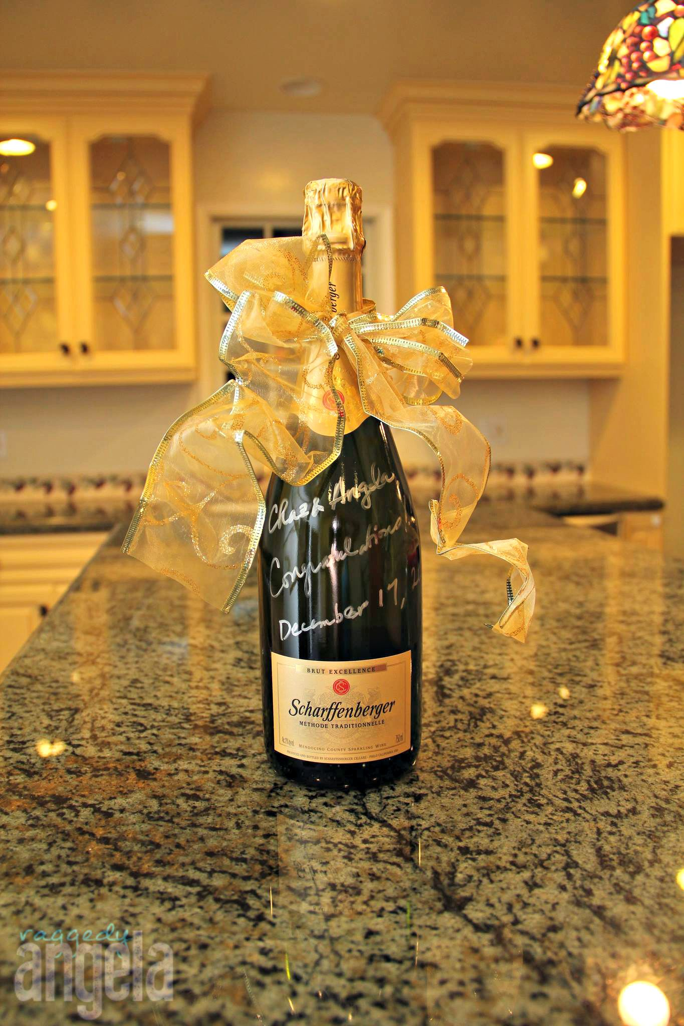 the perfect housewarming gift bottle of champaign pretty ribbon