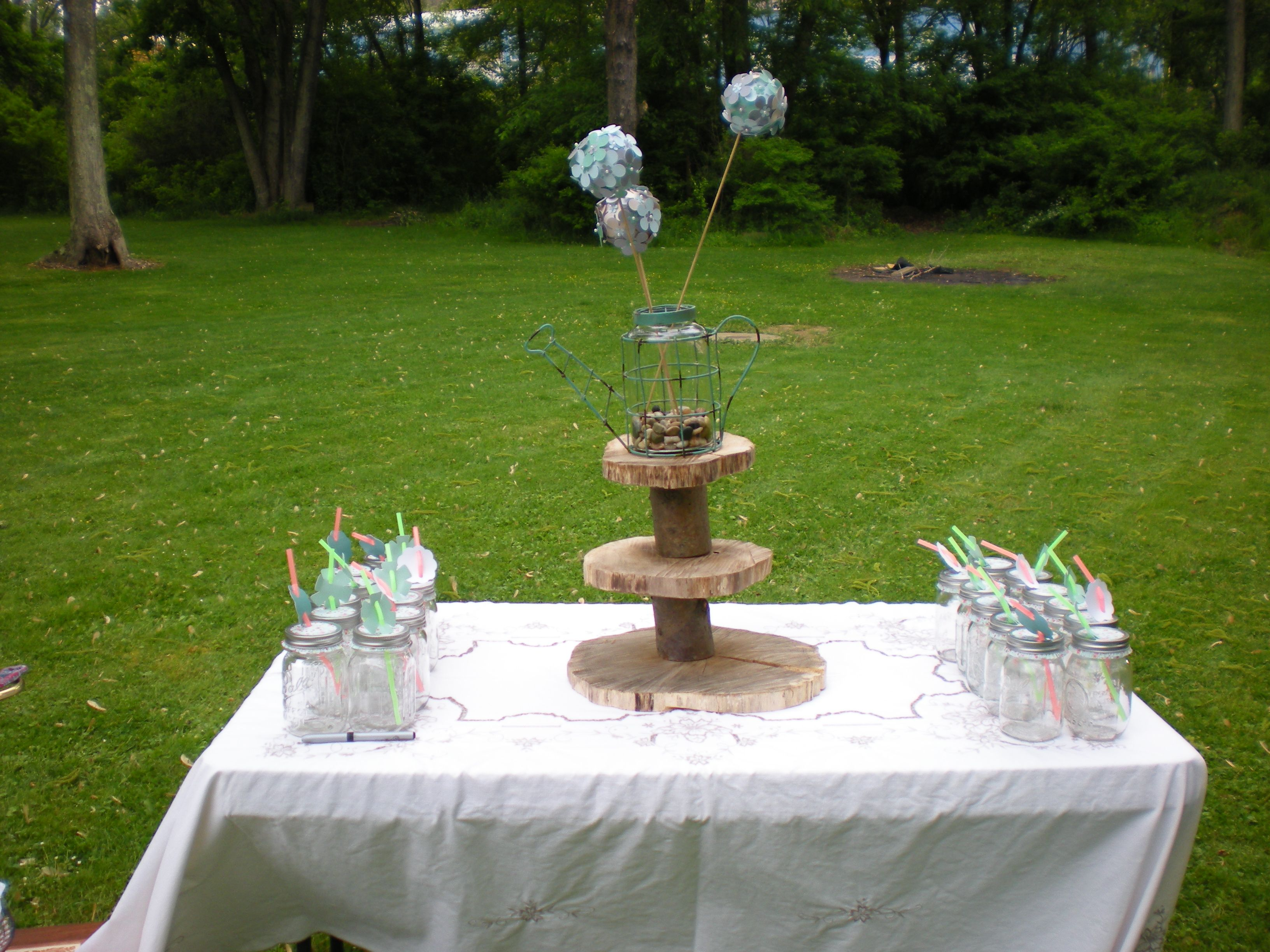 Cup cake stand with the mason jar glasses on my grandmas