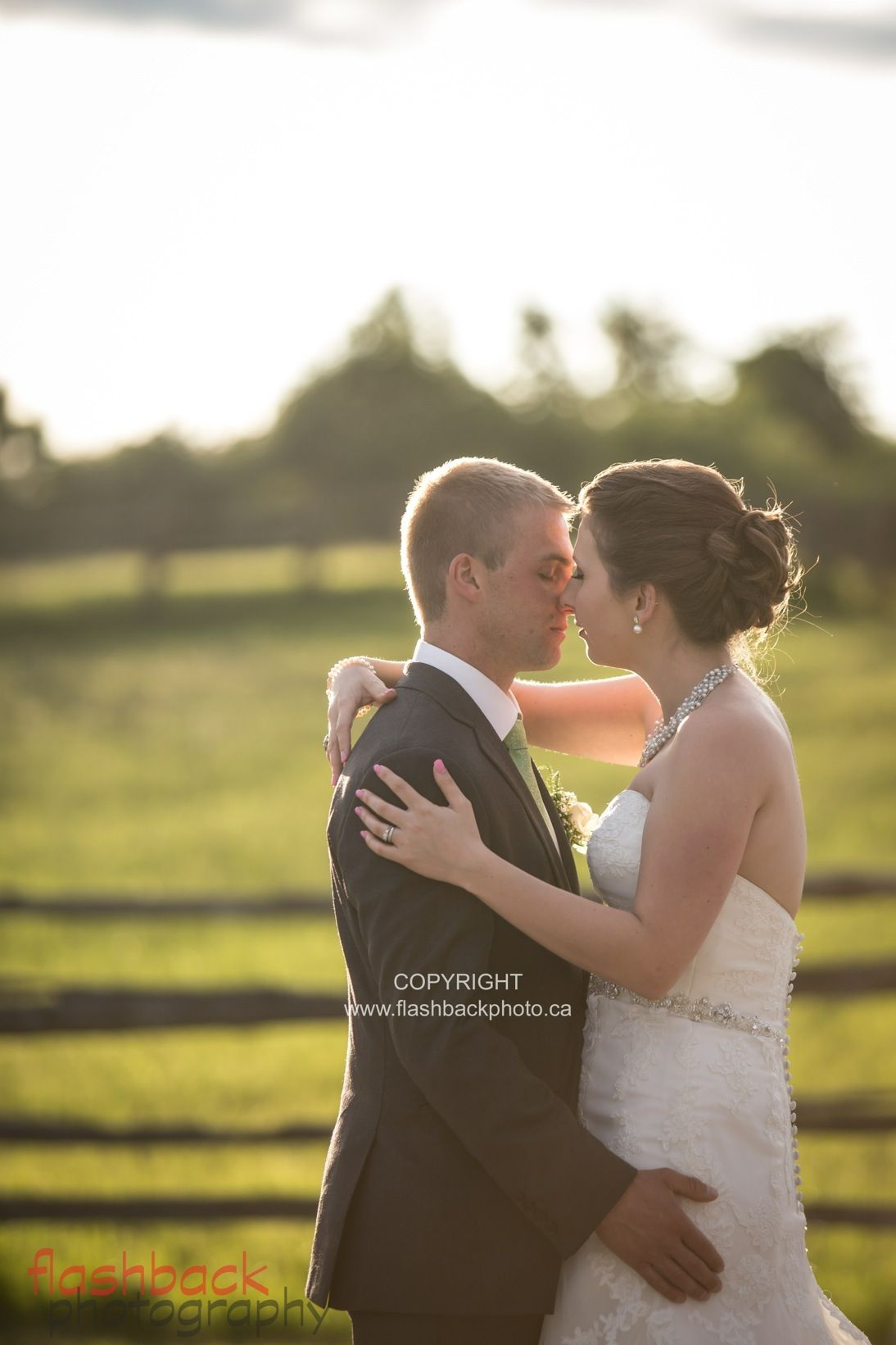 Wedding portrait of couple on family farm in Lindsay, Ontario. Copyright Flashback Photography. www.flashbackphoto.ca.  See more images from this wedding: http://www.flashbackphoto.ca/beautiful-bride-and-groom-farm-portraits/