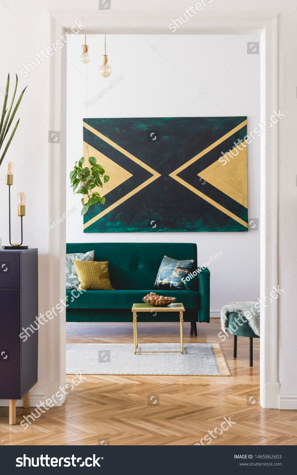 Luxury composition of home interior design with modern velvet sofa, pouf, shelf, pillows, coffee table, plants, elegant accessories and geometric paintings on the wall. Stylish home decor. Template. #Sponsored , #Ad, #sofa#velvet#pouf#pillows