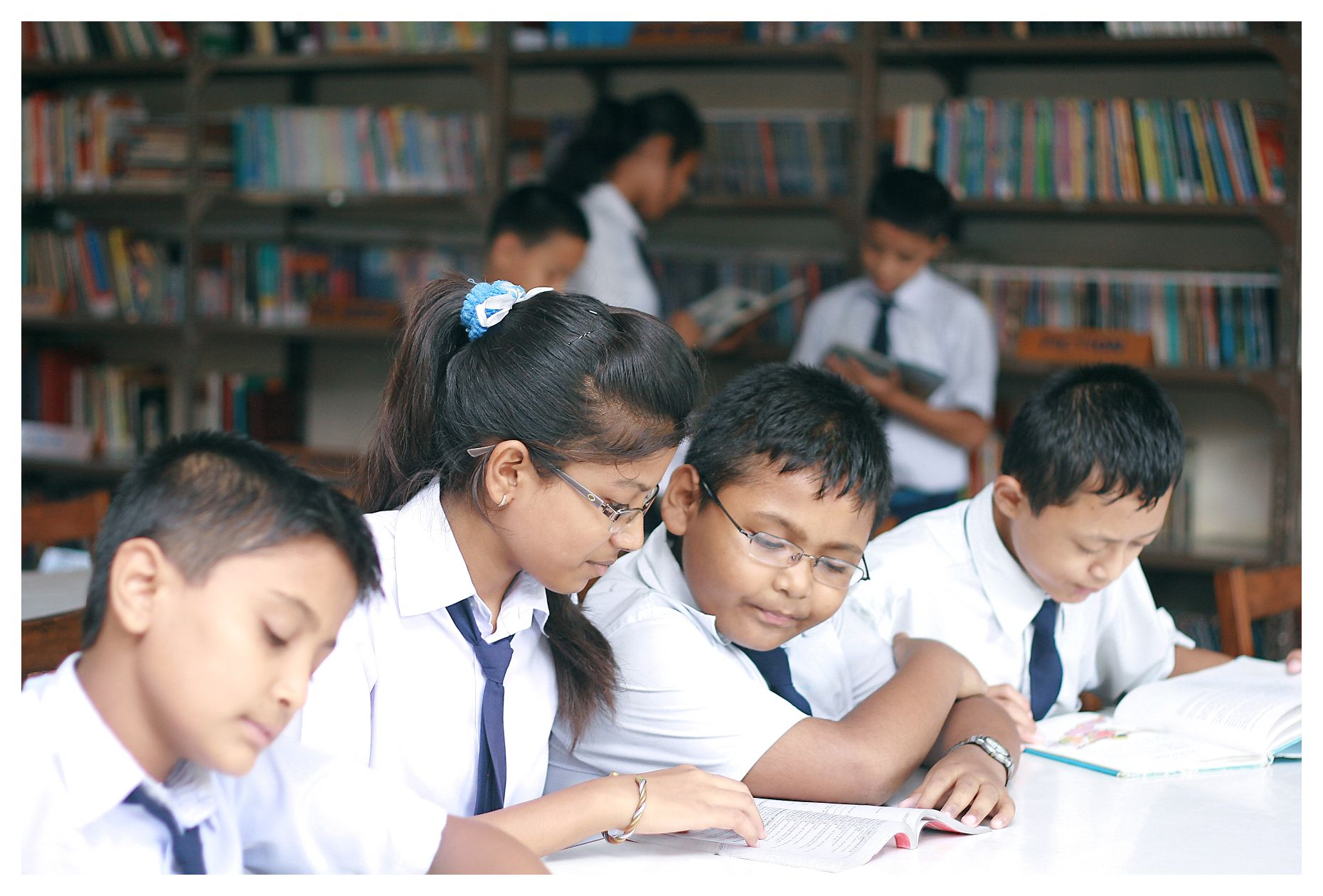 Children reading books in the library at SOS School Itahari in Nepal