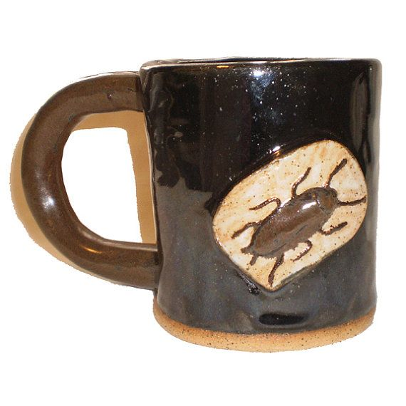 Ceramic Cockroach Inside Coffee Cup