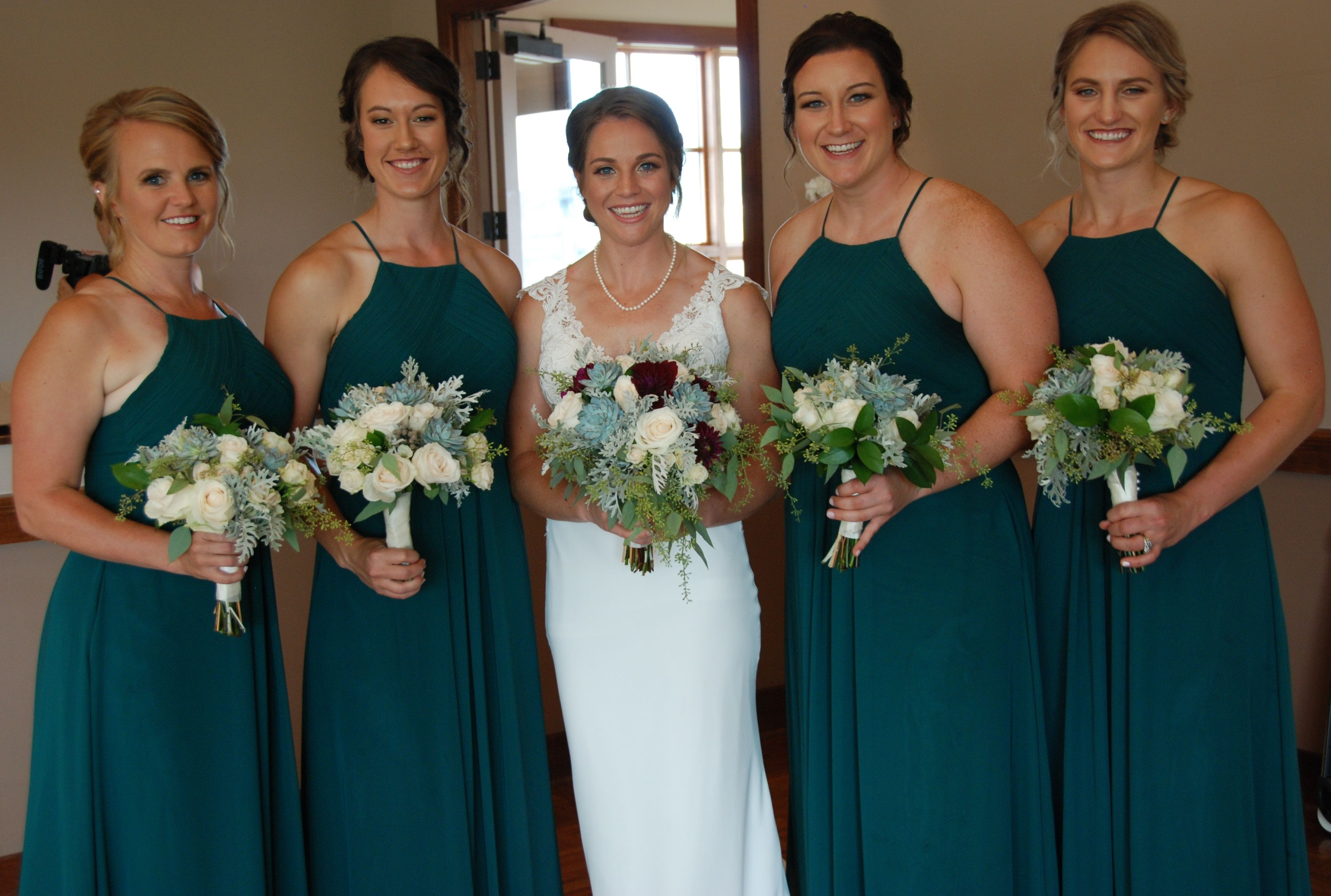 Green Bridesmaid Dresses With Bouquets Of Succulents And Ivory