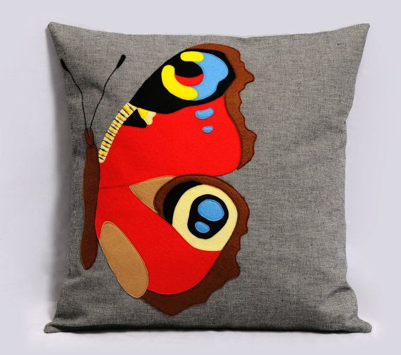 Peacock Butterfly Decorative Pillow Cover, dark Gray Cotton, Felt Pillow, 18x18 inches, Multicolor, Bright, Primary Colors, Made to Order. $40.00, via Etsy.