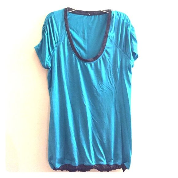 Lululemon Athletica Top in Teal Running top in technical fabric - wicks great! Very rarely worn and in good condition. Very little pilling. Make me an offer! lululemon athletica Tops Tees - Short Sleeve