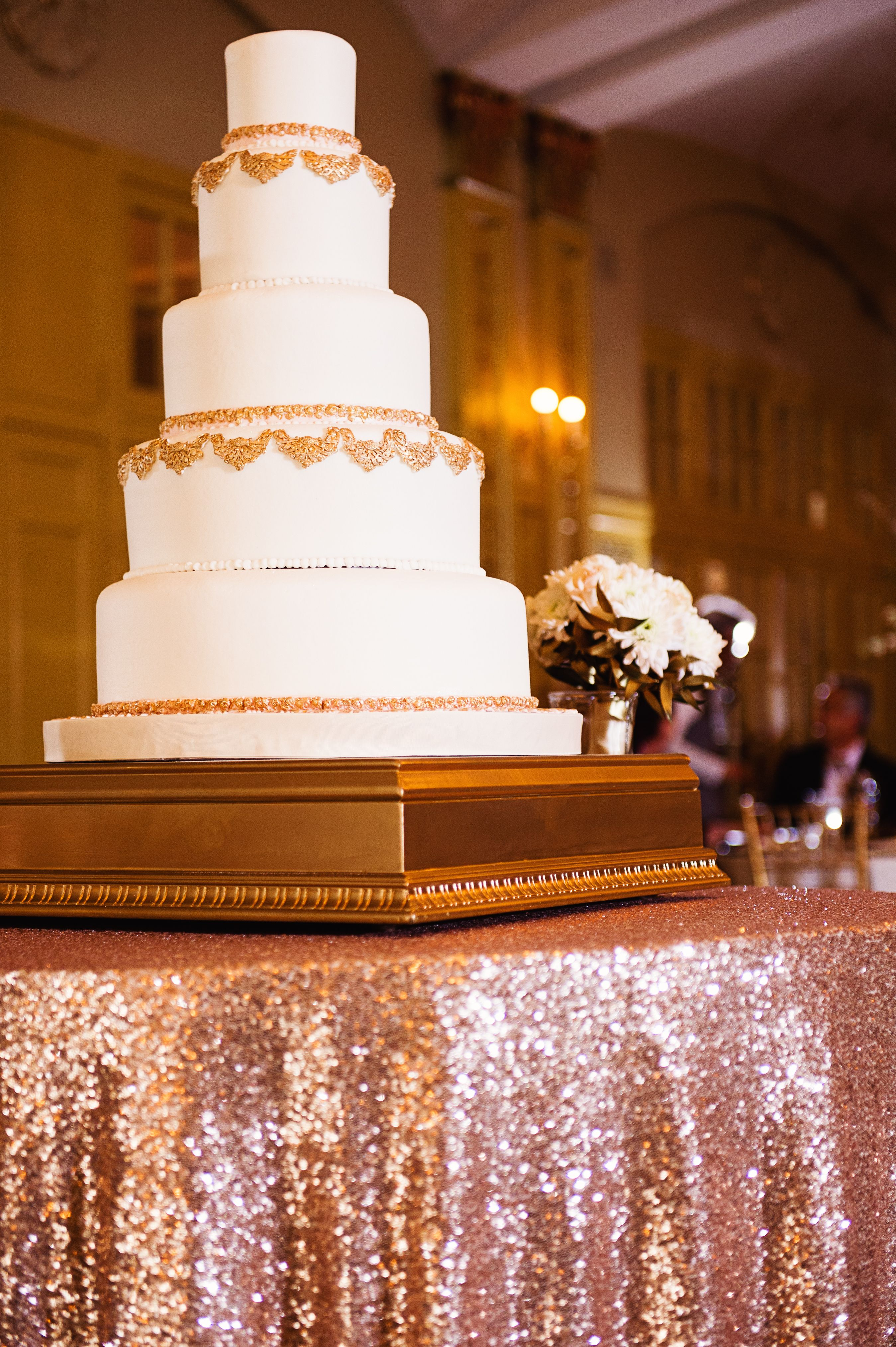 Wedding cake table decor ideas  Ornate Gold and Ivory Wedding Cake  wedding  Pinterest  Ivory