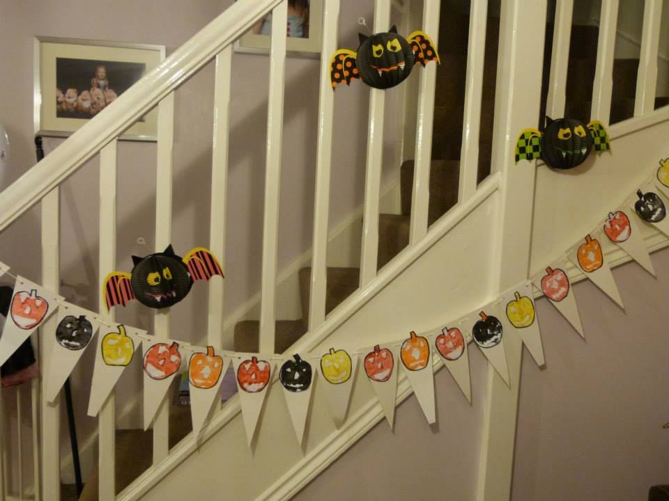Halloween banner made from apple prints that look like pumpkin faces