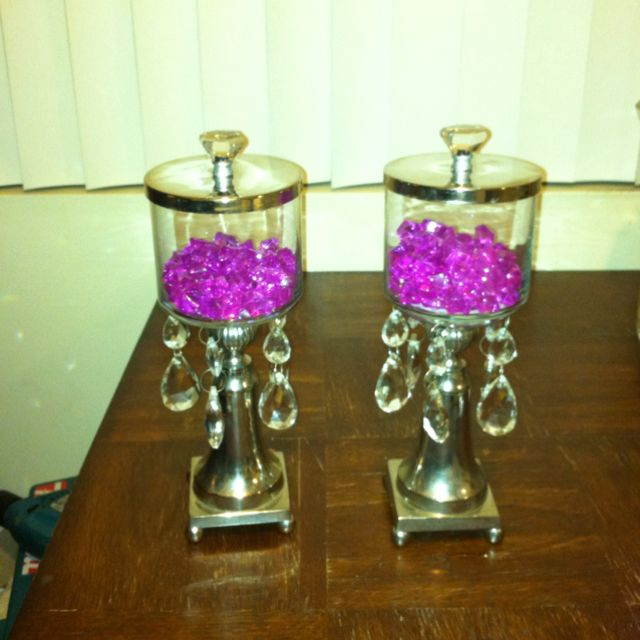 Apothecary jars made from empty candle jars and old candlestick holders. These are how mine came out. -Krystal