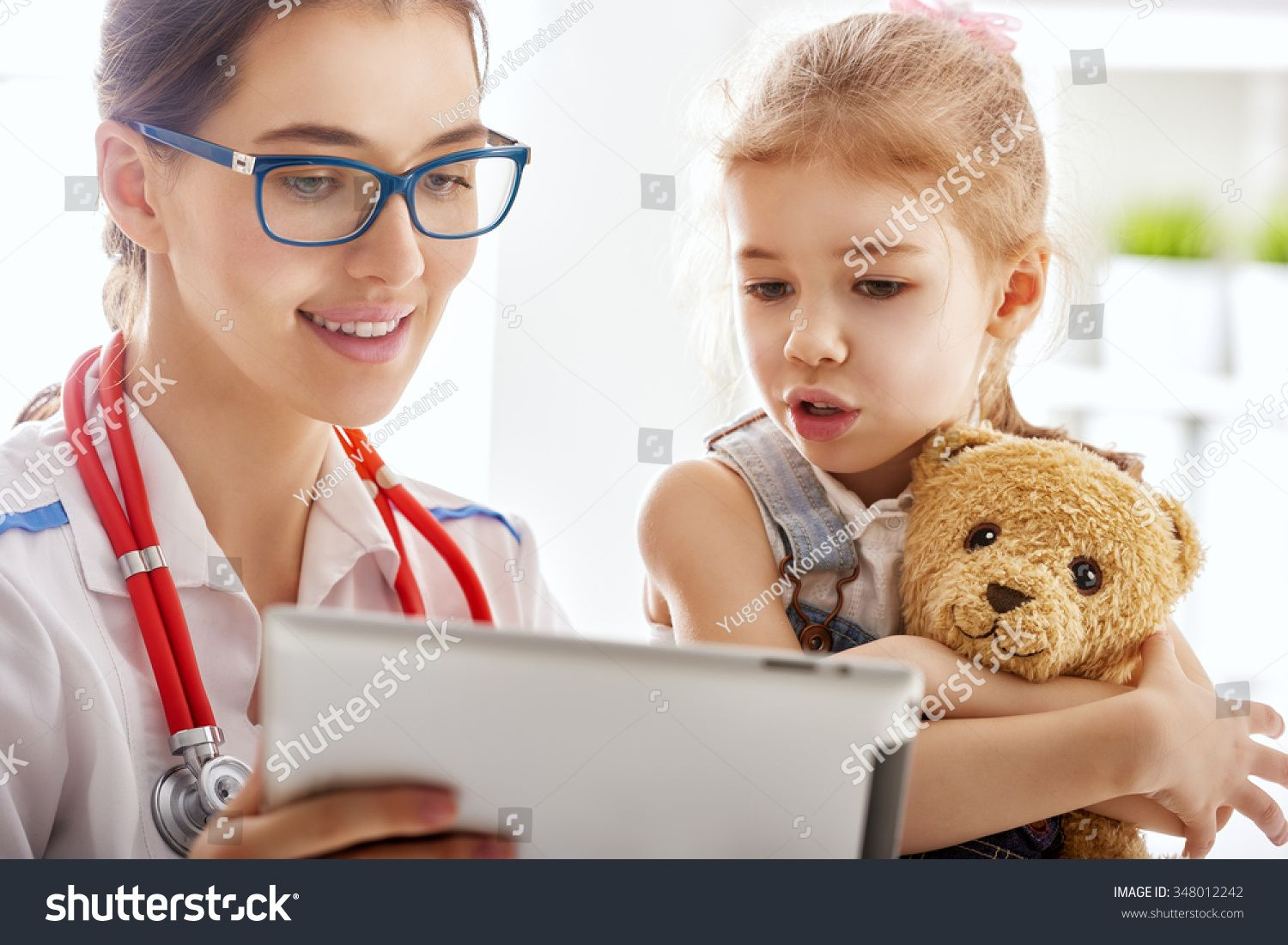 doctor examining a child girl in a hospital Ad , Ad,