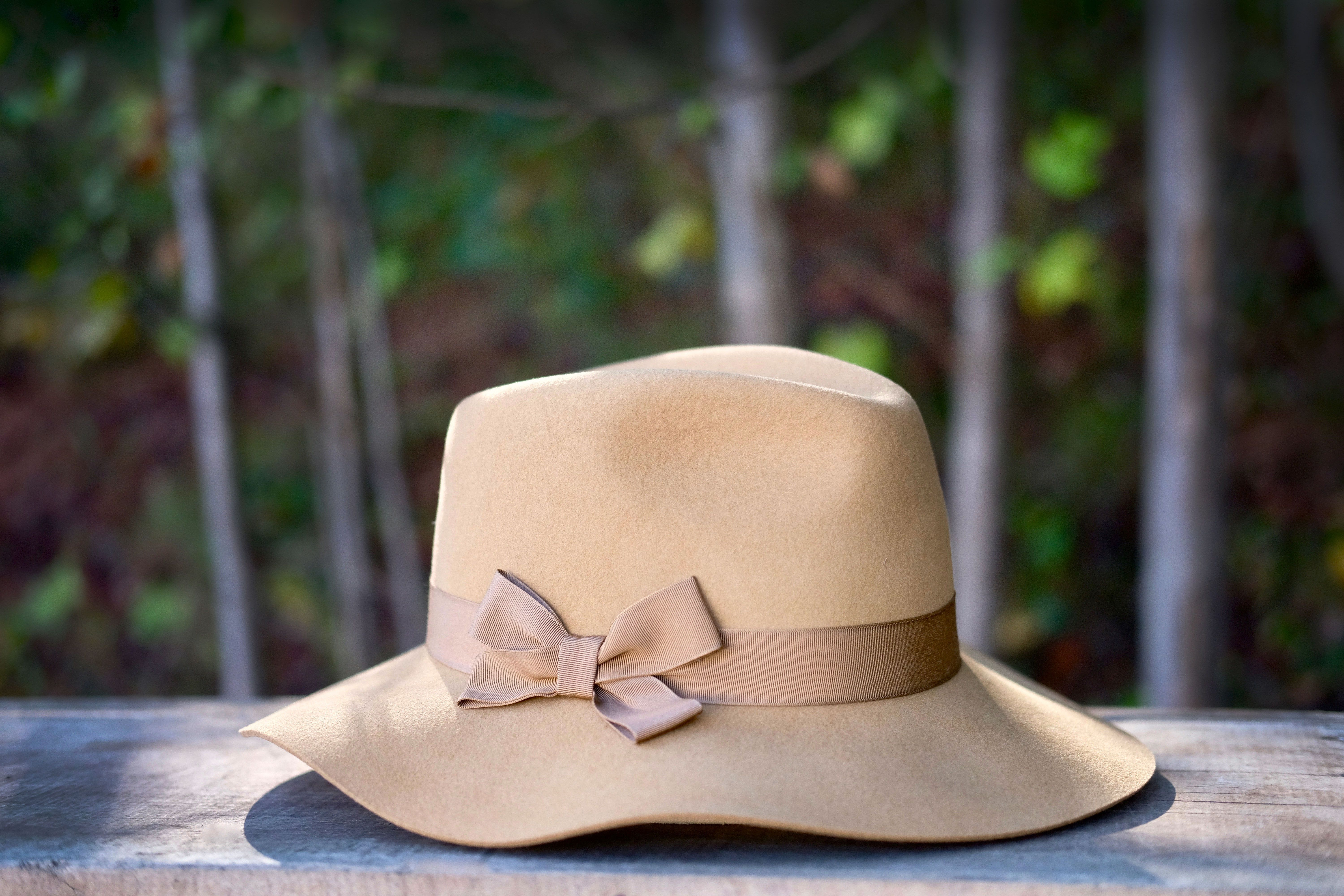 e87458cf The Gwen hat is a unique women's style. It has a wide brim and a feminine  grosgrain hatband with a bow but, the crown has a classic fedora shape to  it which ...