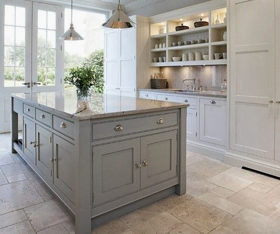 white kitchen with a gray island