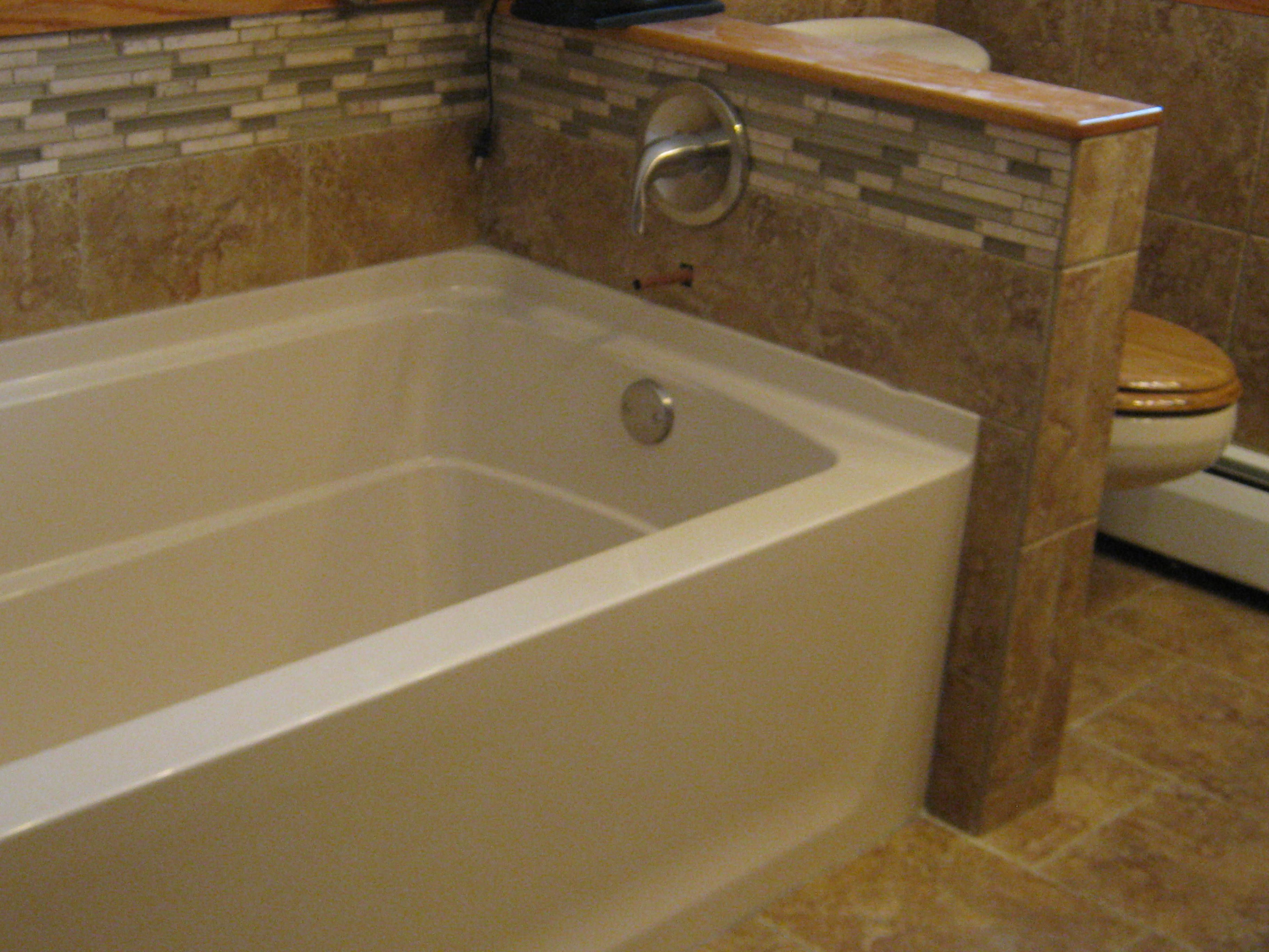 Sterling Ensemble acrylic tub with custom tile wainscoting and tub ...