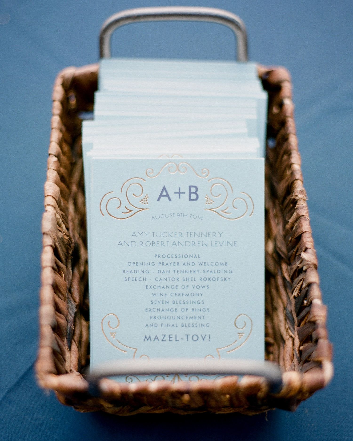 These light blue wedding programs, topped with the happy couple\'s ...