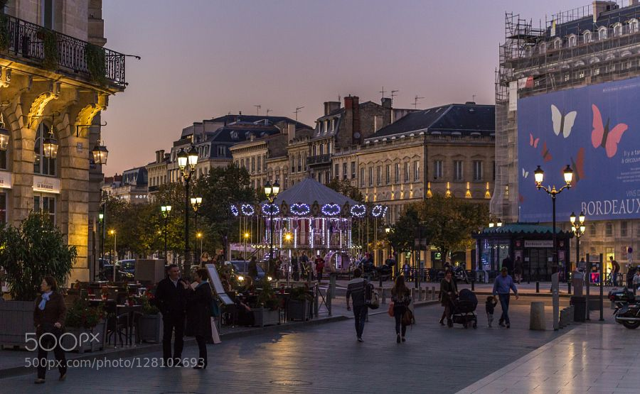 Place Tourny - Bordeaux Walking down the street looking around Enjoying the evening while is running the merry-go-round.