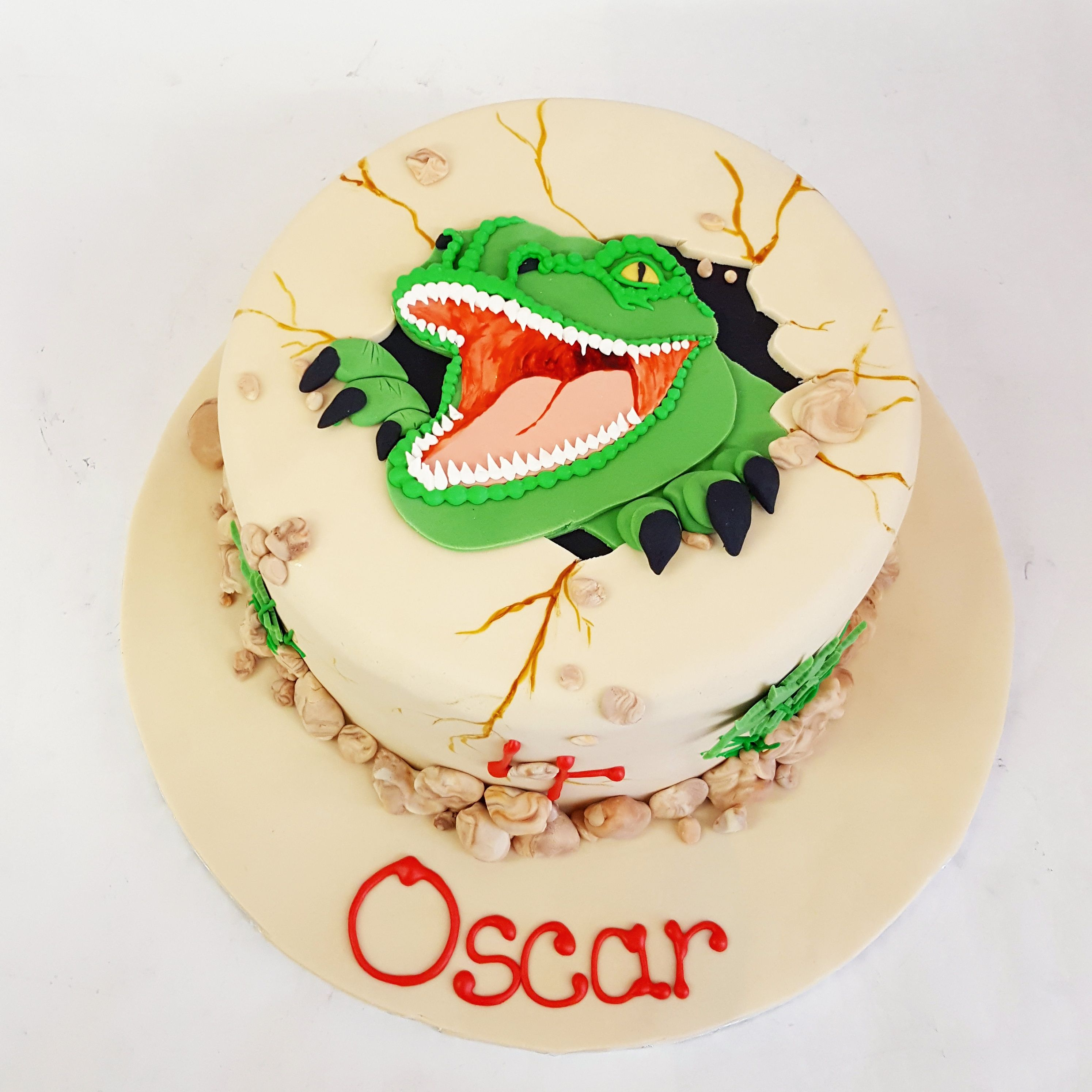 This dinosaur is breaking out of the cake Birthday Cakes for Kids