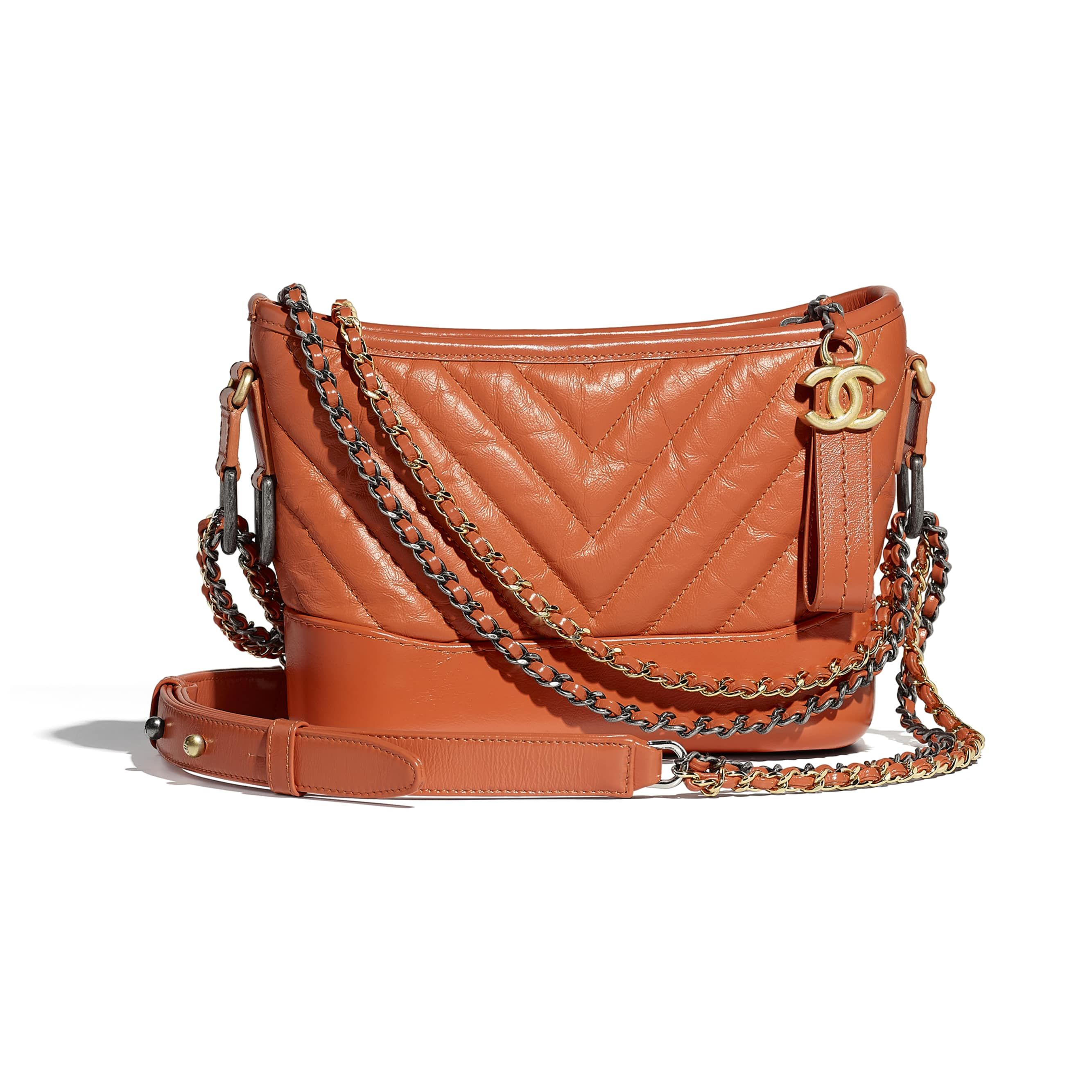 f0d65d9bec0 Chanel - PRE FW2018 19   Aged calfskin, smooth calfskin, silver-tone    gold-tone metal orange Chanel s Gabrielle small Hobo bag ( 3,900)