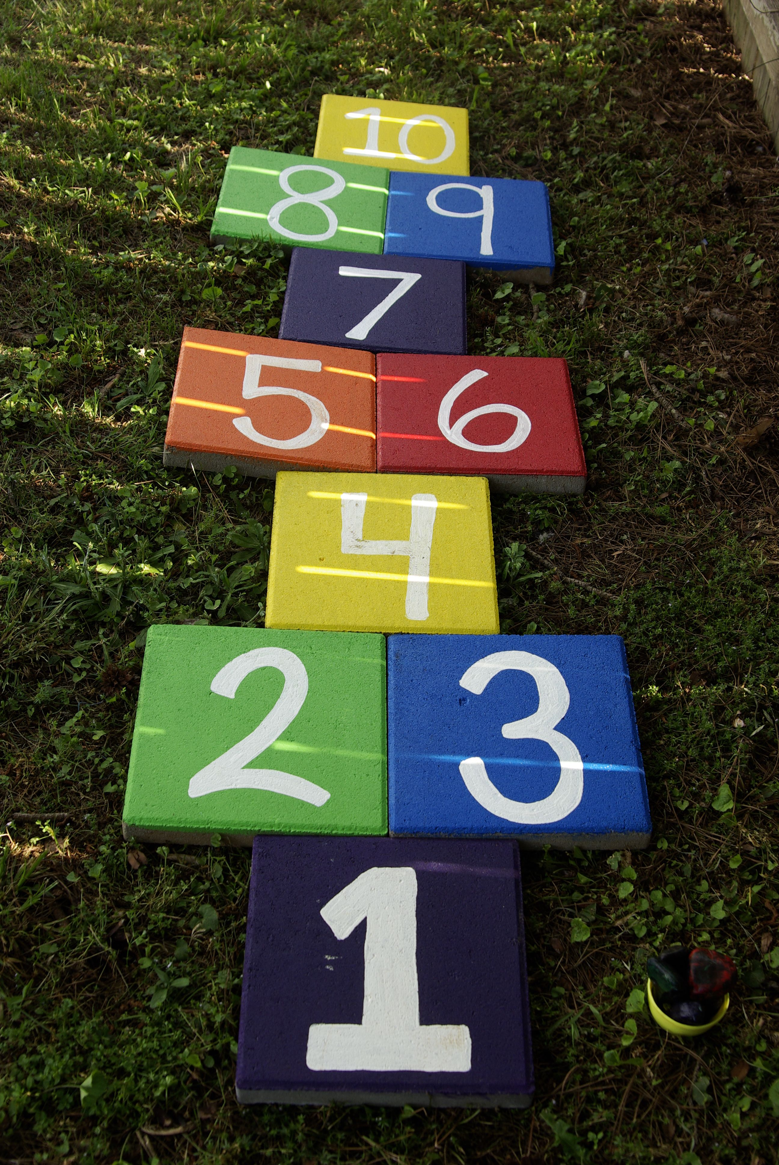 hopscotch we made for our backyard painted concrete pavers and