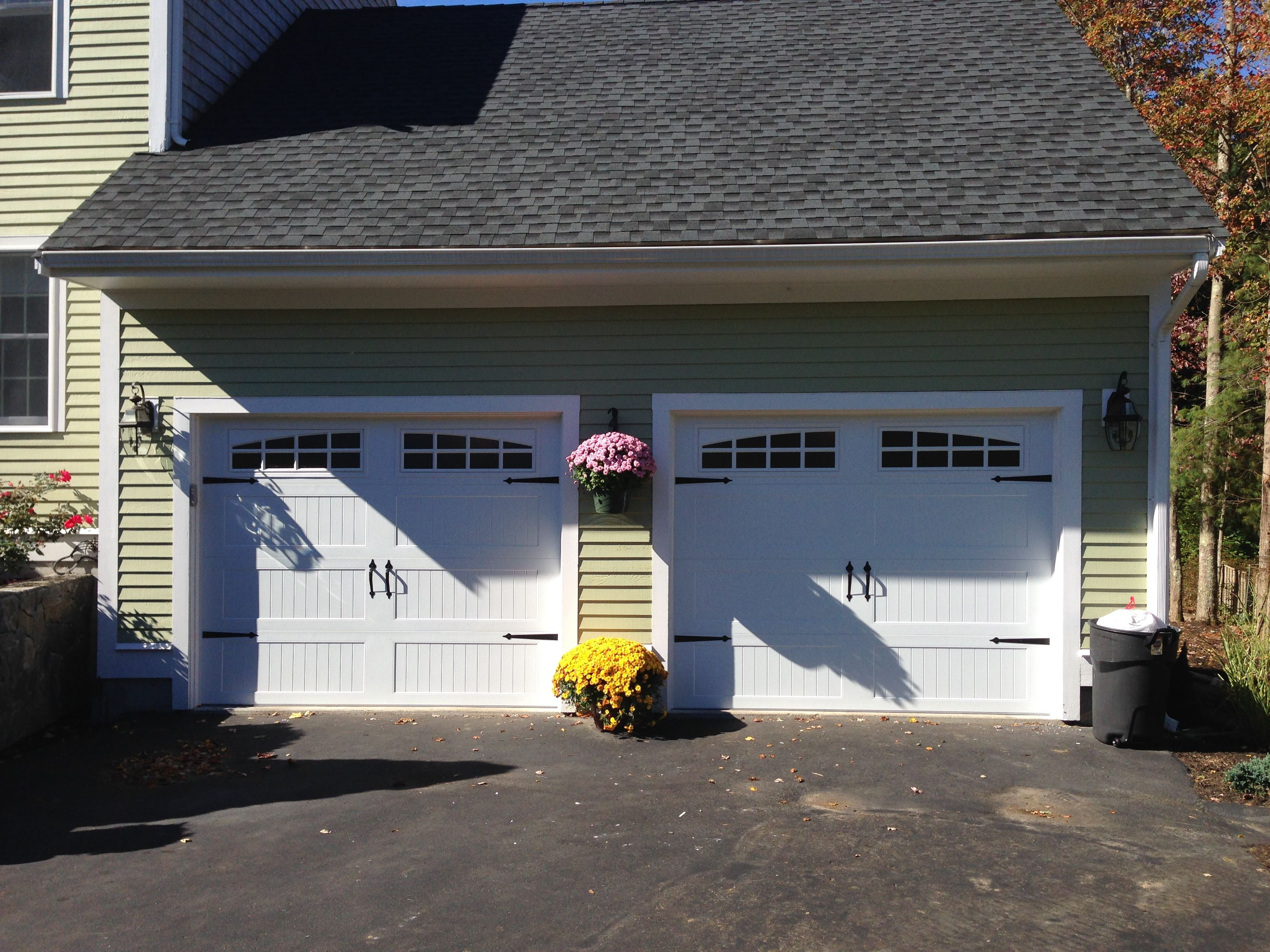 Haas model 660 steel carriage house style garage doors in white haas model 660 steel carriage house style garage doors in white with 6 pane glass flat black spade decorative hardware installed by mortland ove rubansaba
