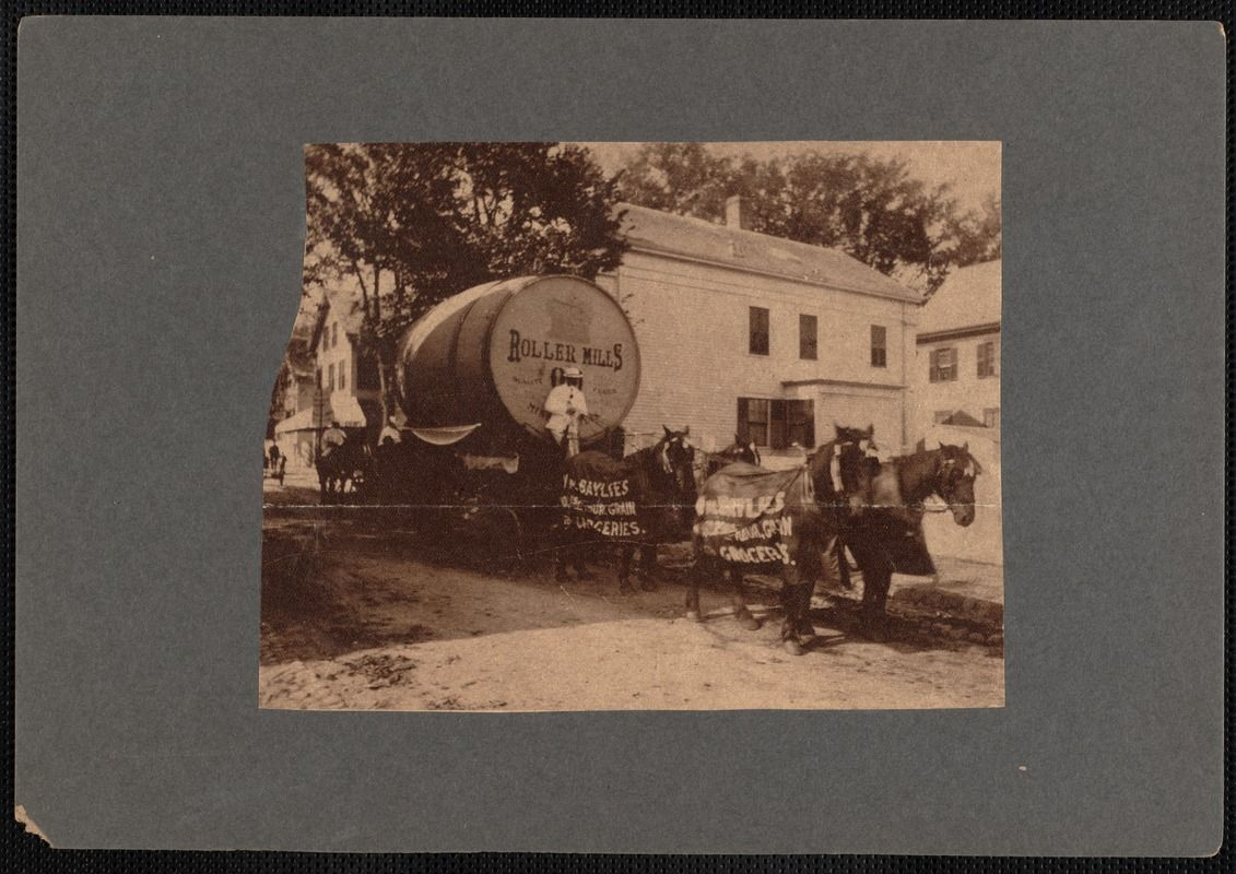 Giant keg labeled Roller Mills on carriage drawn by four horses wearing blankets advertising William Baylies Grain Co., Maxfield Street and State Street, New Bedford, MA, during New Bedford semi-centennial, 1897.